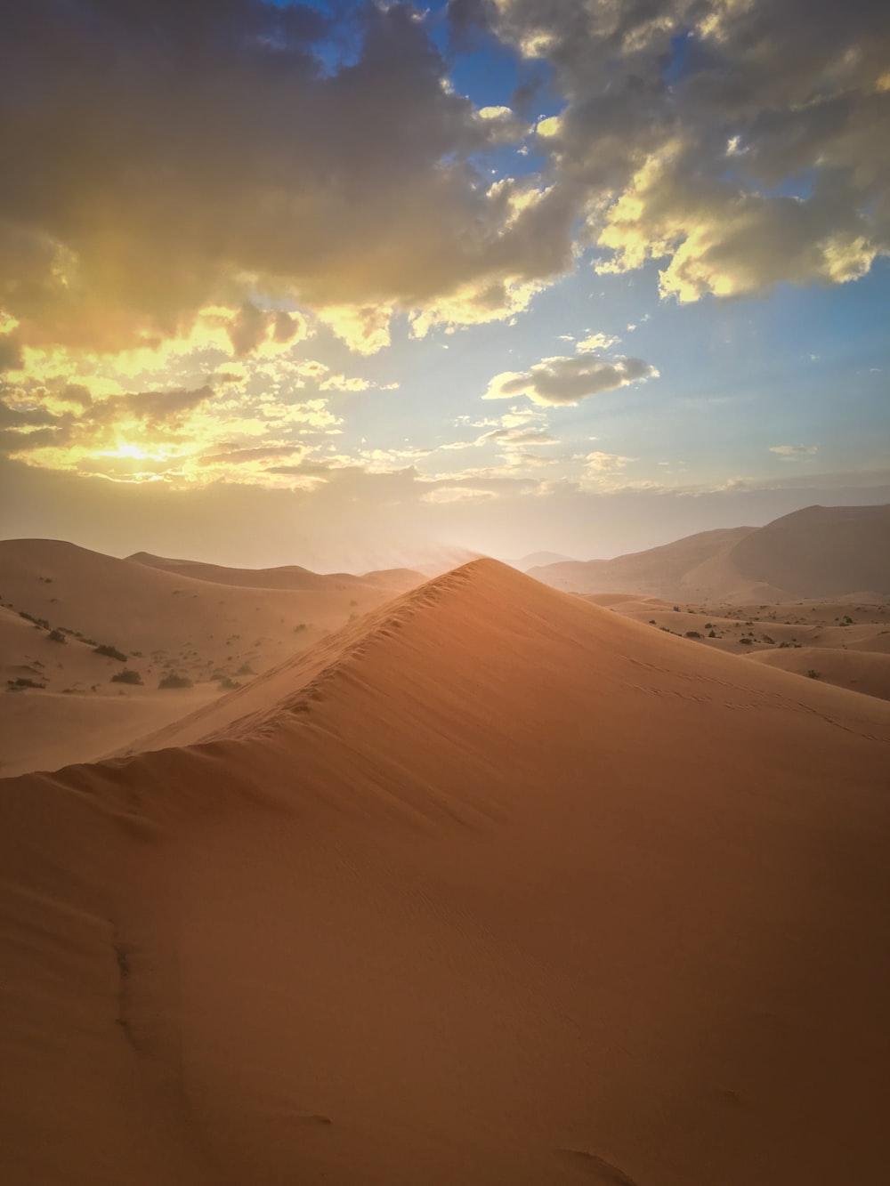 desert under white and blue sky