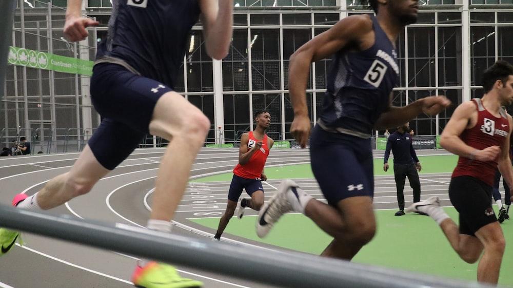 men running on field