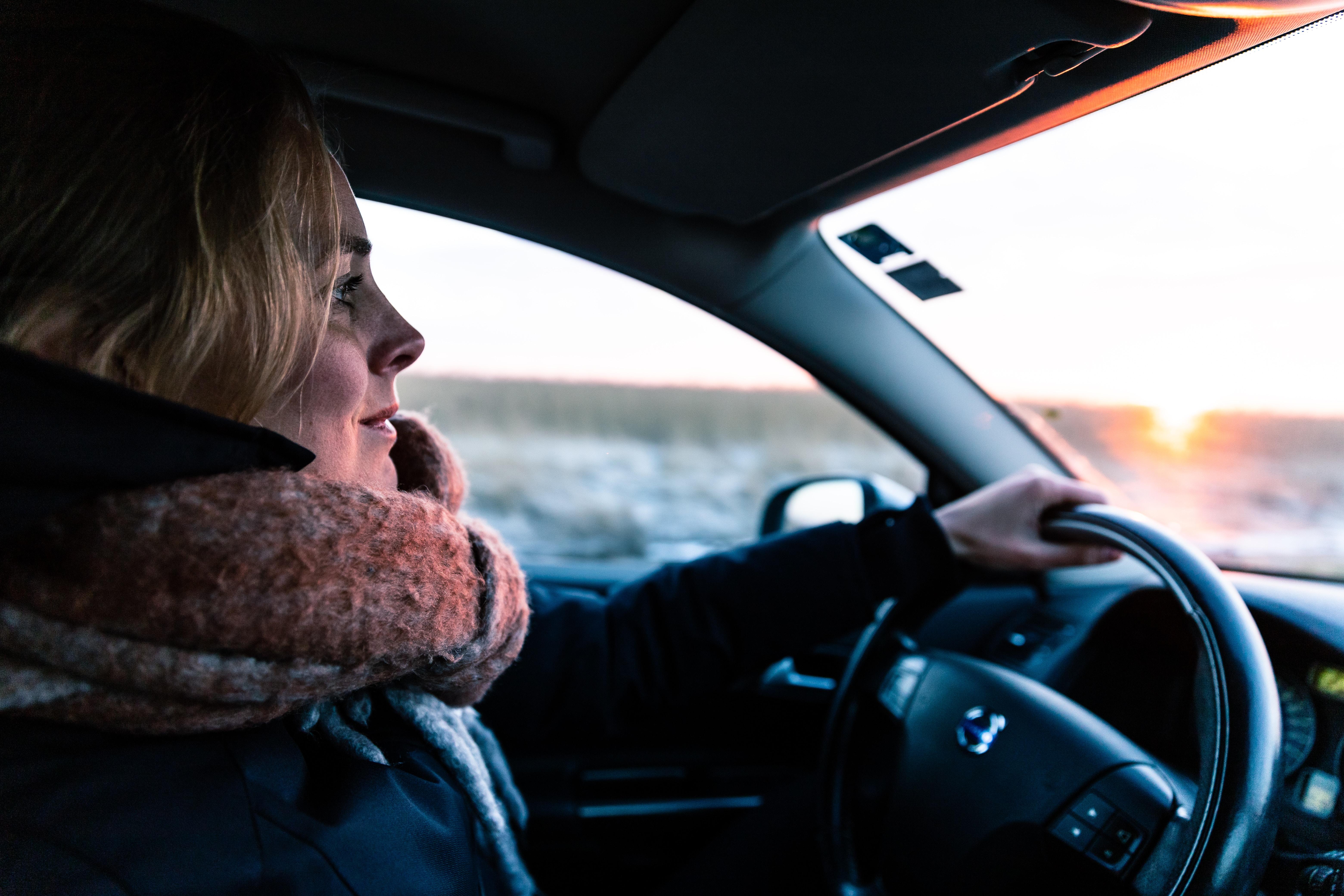 woman driving vehicle during daytime