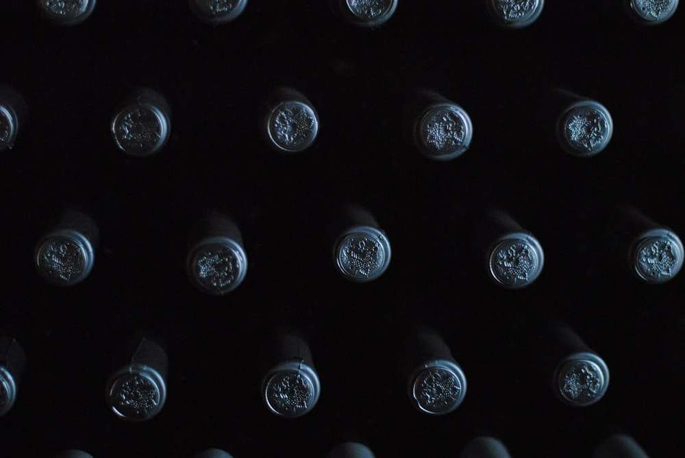 close-up photography of glass bottles with lid
