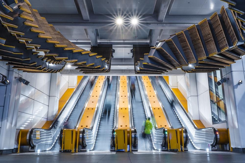 people on escalators inside building