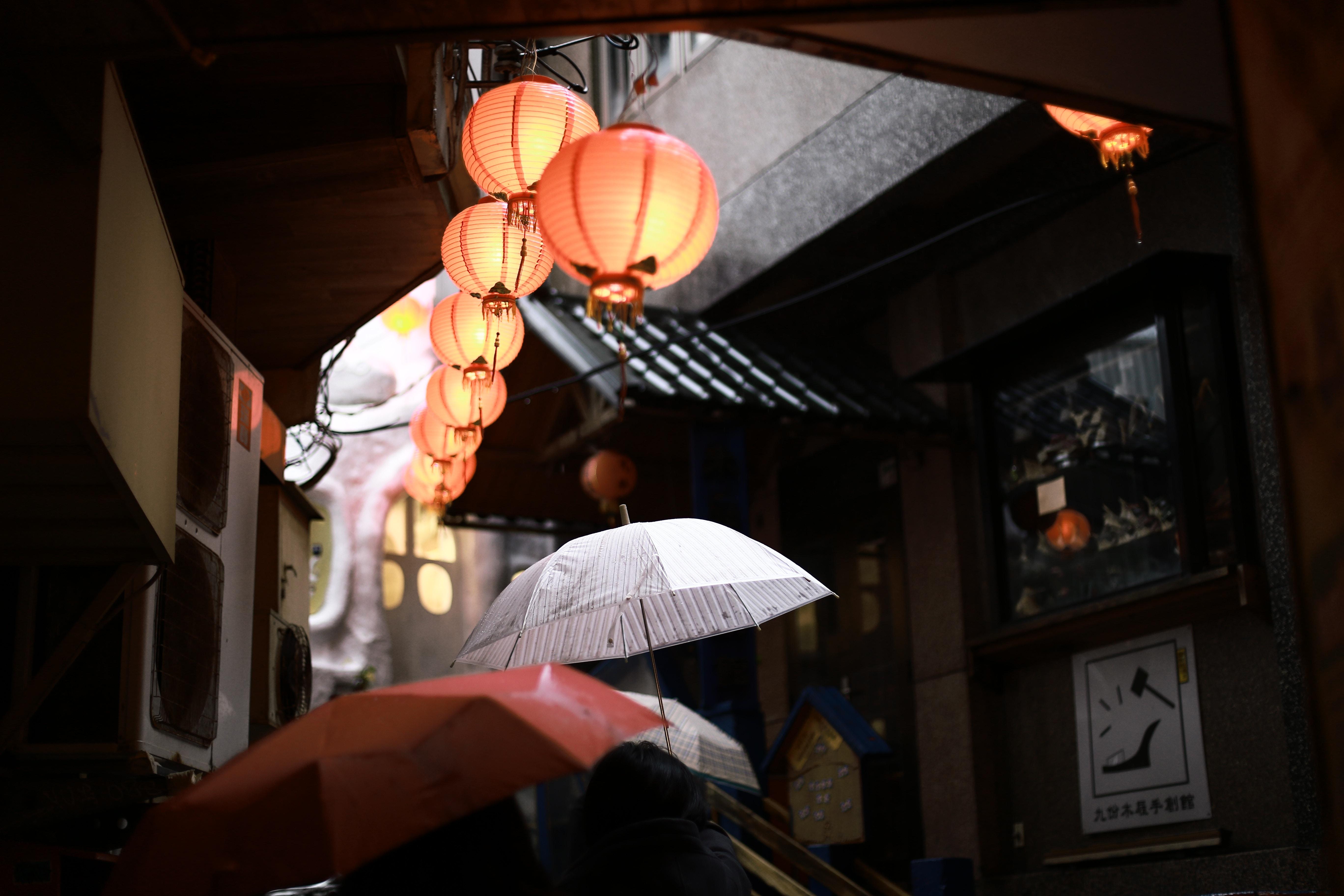 white handheld umbrella