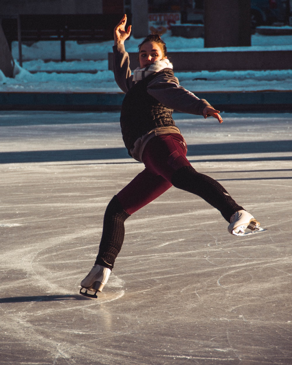 woman performing on ice skate field