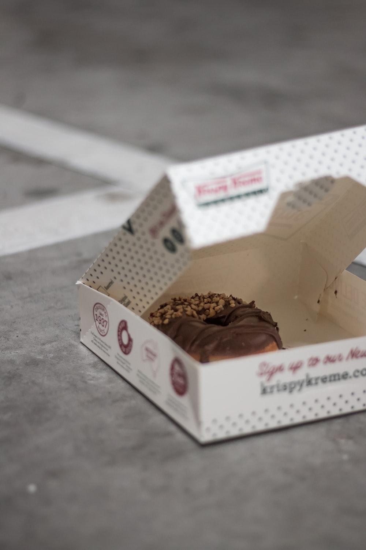 chocolate covered Krispy Kreme donut with box