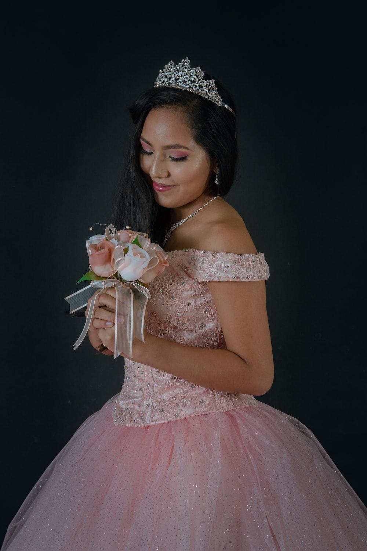 woman wearing pink off-shoulder dress