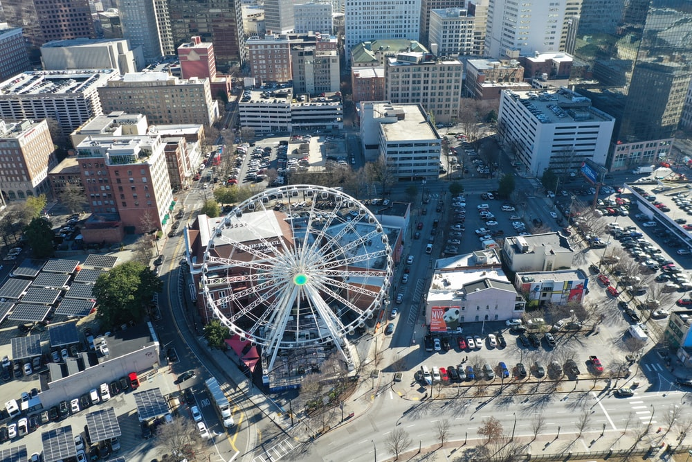gray ferris wheel surround by buildings