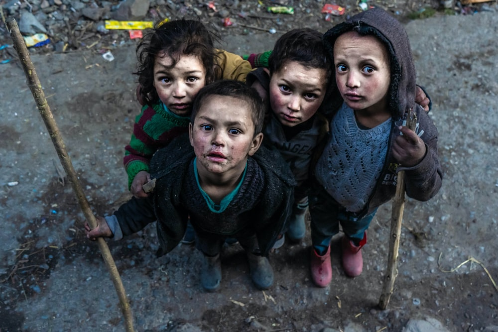 four children holding sticks