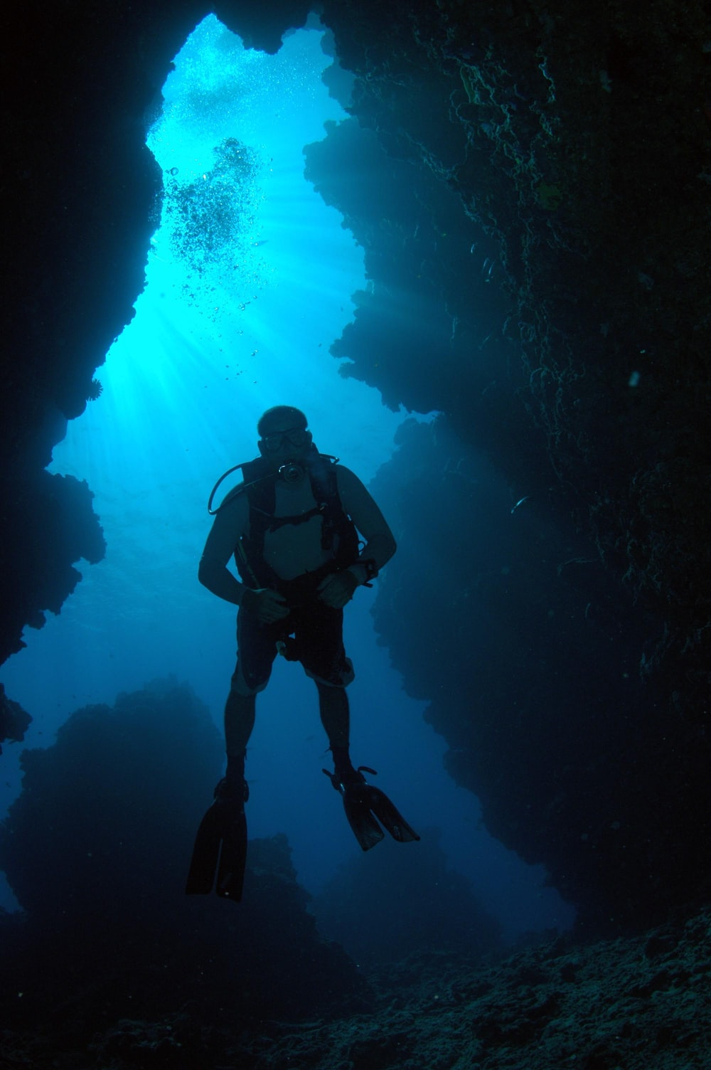 person scuba diving underwater during daytime
