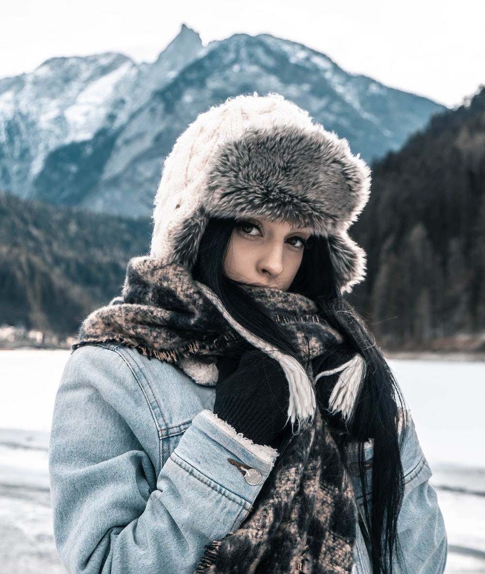 woman standing on front of snow mountain