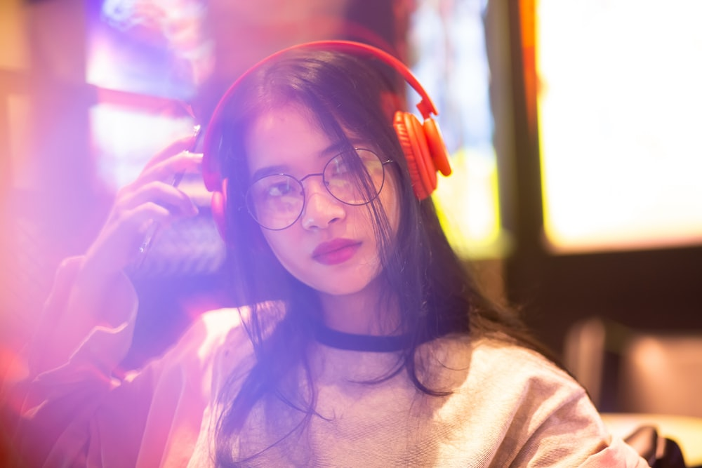 woman using headphones and looking side view