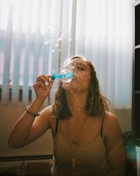 woman playing balloon indoor