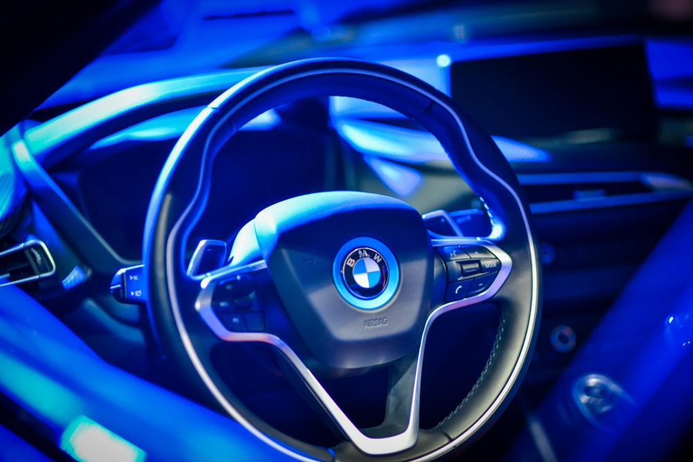 closeup photo of black and gray BMW steering wheel