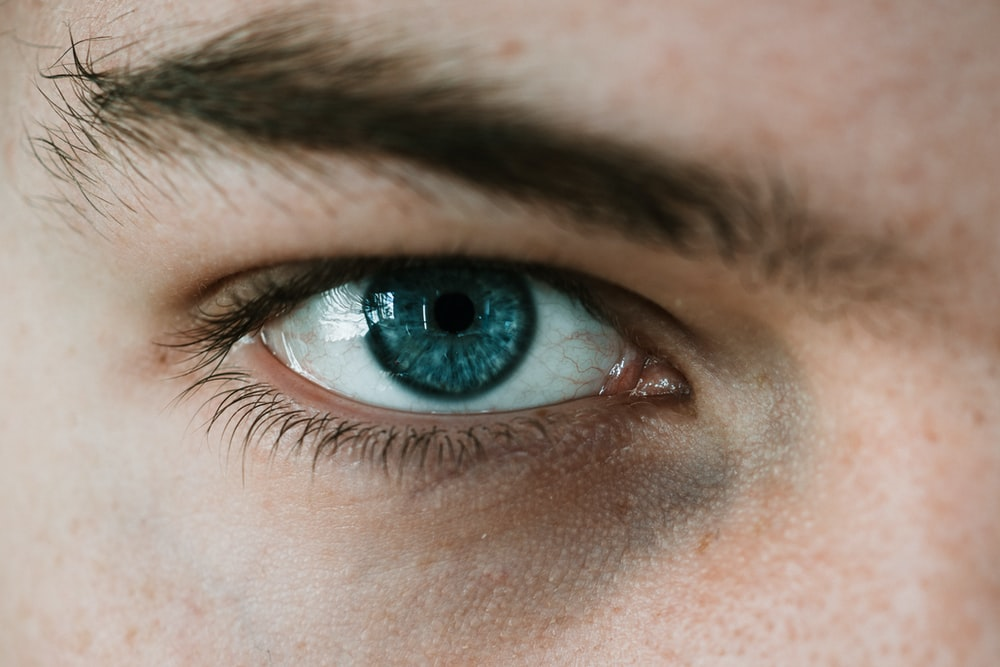 selective focus photography of person's eye