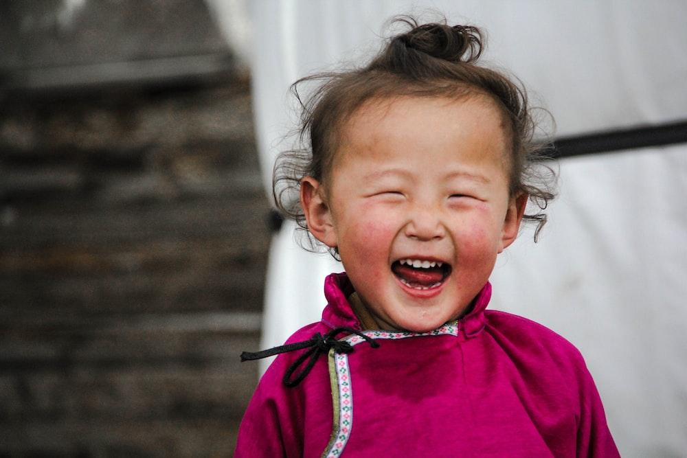smiling girl wearing pink dress