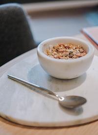 stainless steel spoon beside bowl