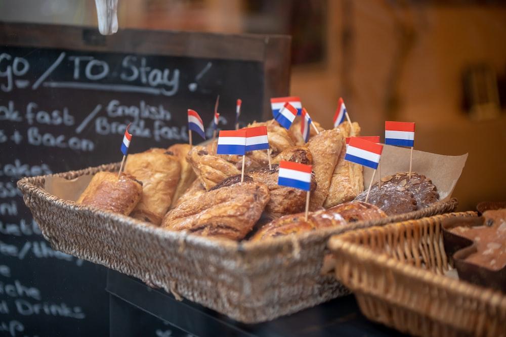 baked pastries on brown wicker basket