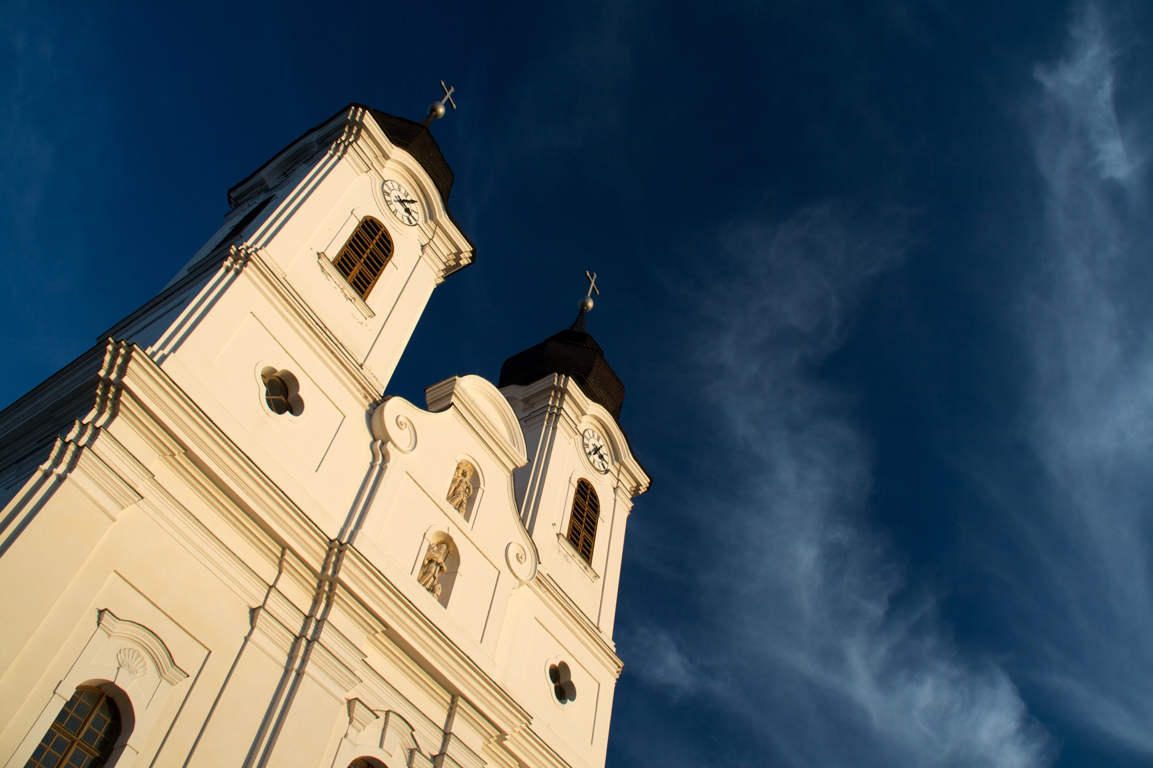 low angle photo of white cathedral under blue sky