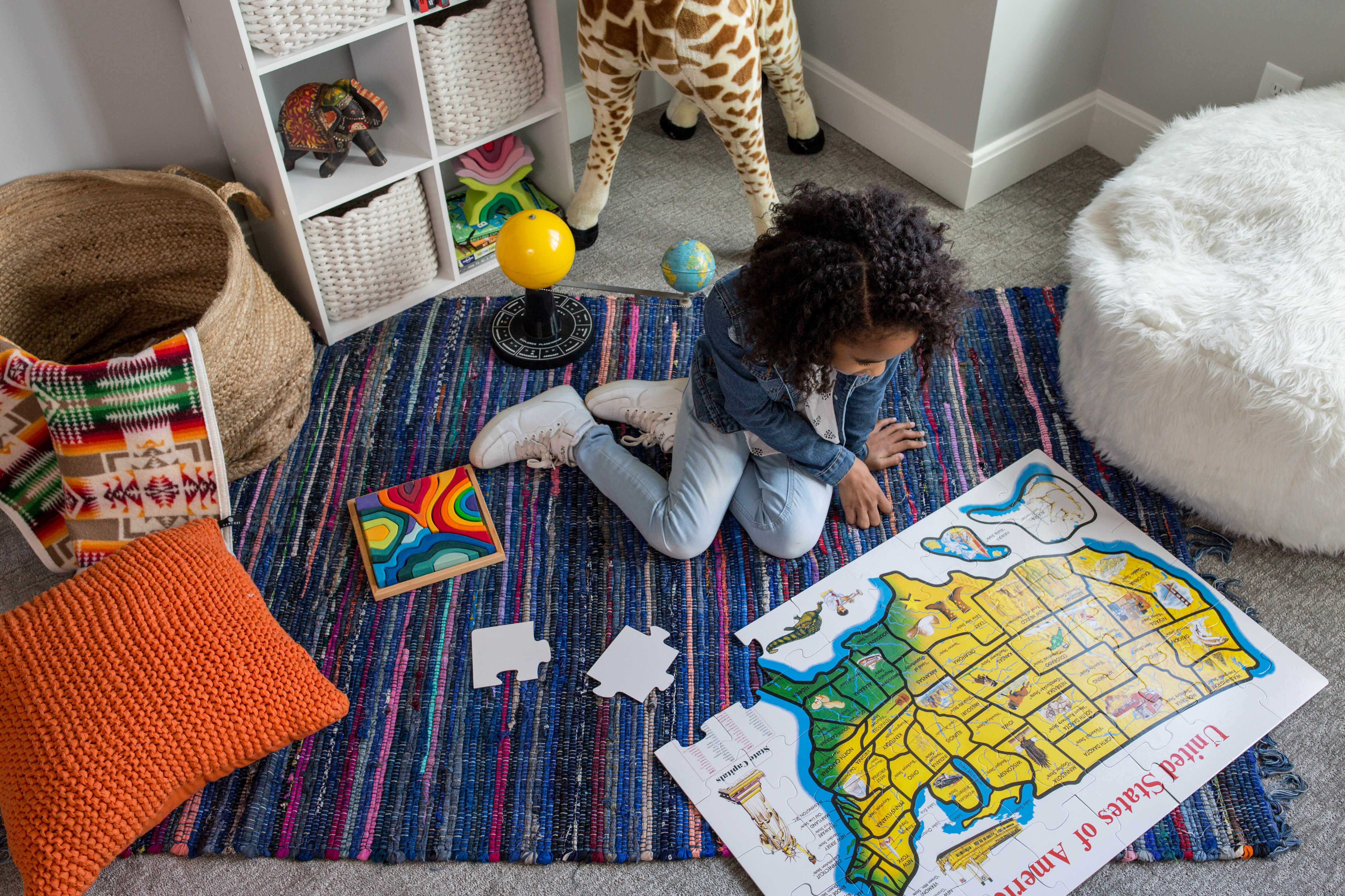 girl playing map jigsaw puzzle