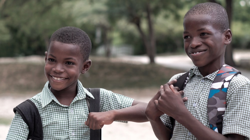 2 smiling boys in uniform