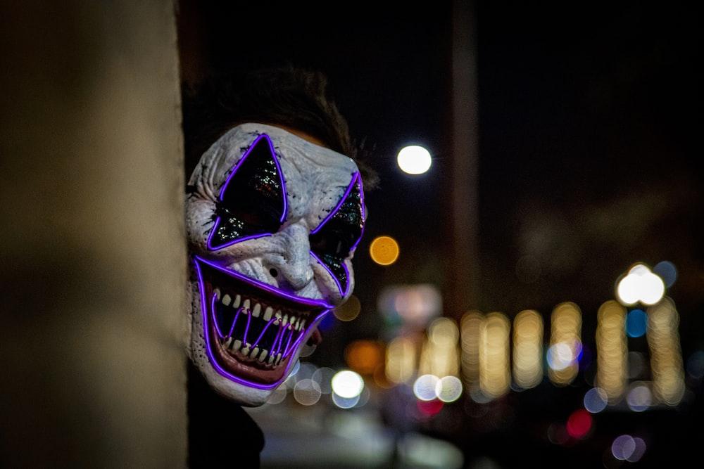shallow focus photography of clown makeup