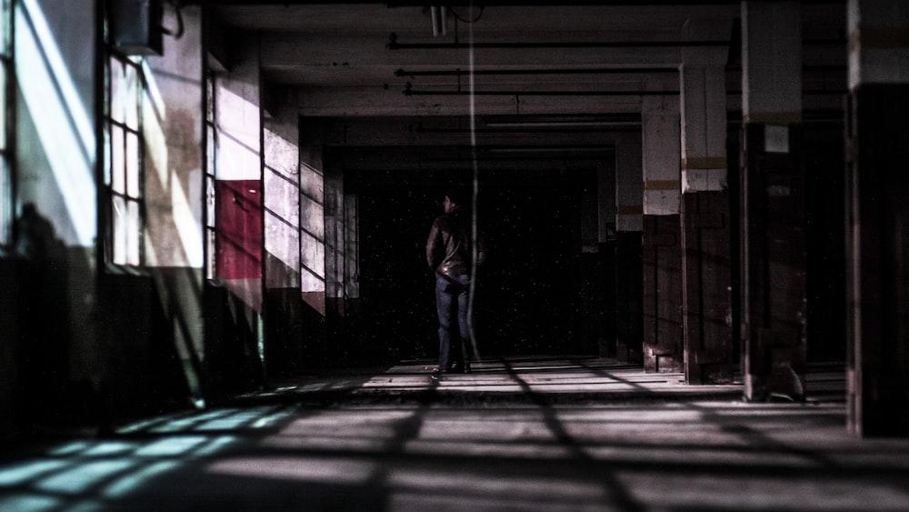 man standing in building