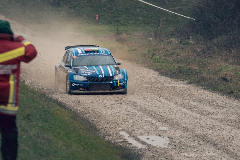 blue Skoda Rapid hatchback WRC on dirt track during daytime