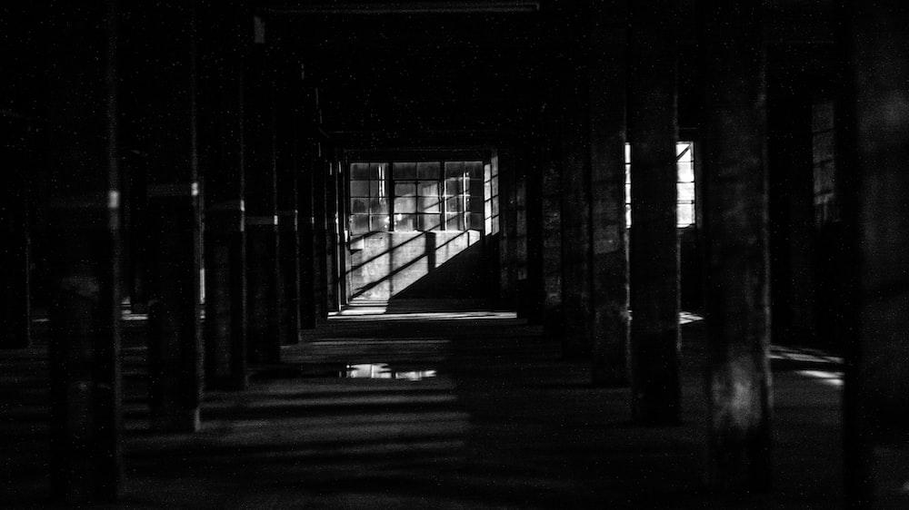 light streaking through opening under dark tunnel
