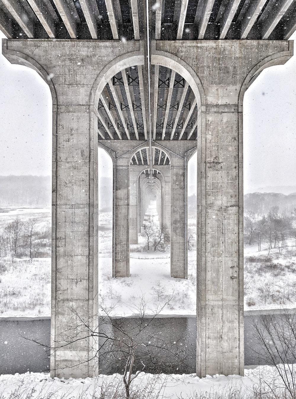 gray concrete bridge with snow