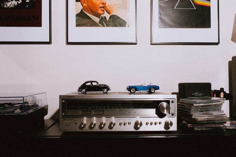 gray AV receiver on brown wooden table