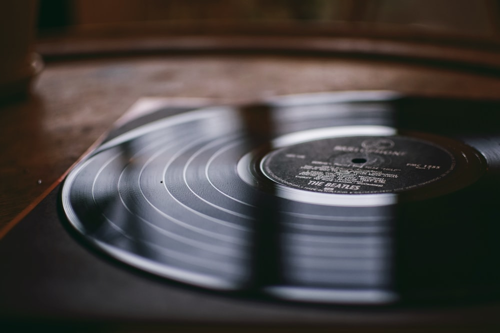 shallow focus photo of vinyl record