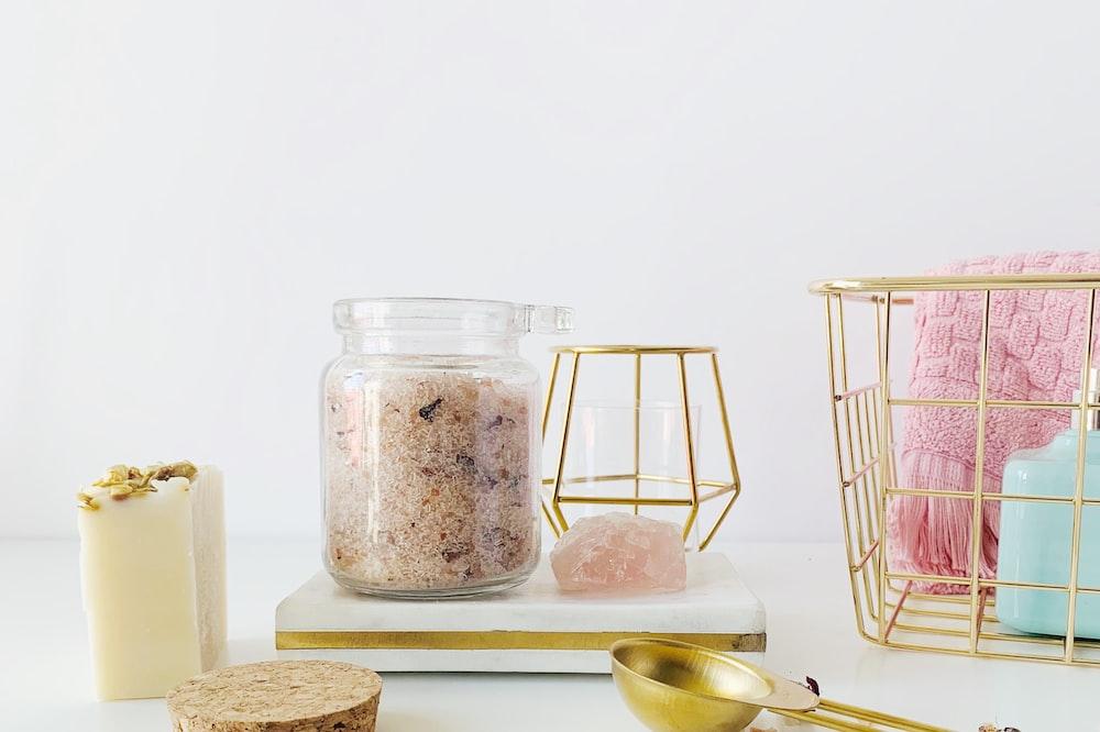 clear glass jar near white surface