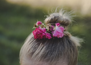 close-up photo of girl with flower bun on hair