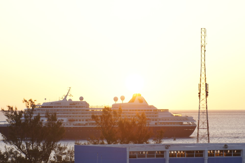 white and black ship during golden hour