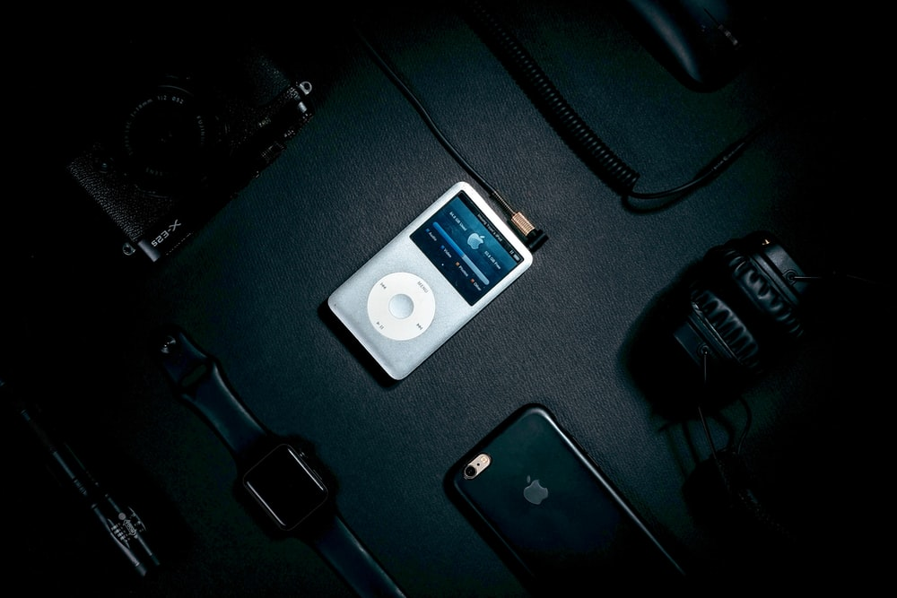 turned on iPod on black surface