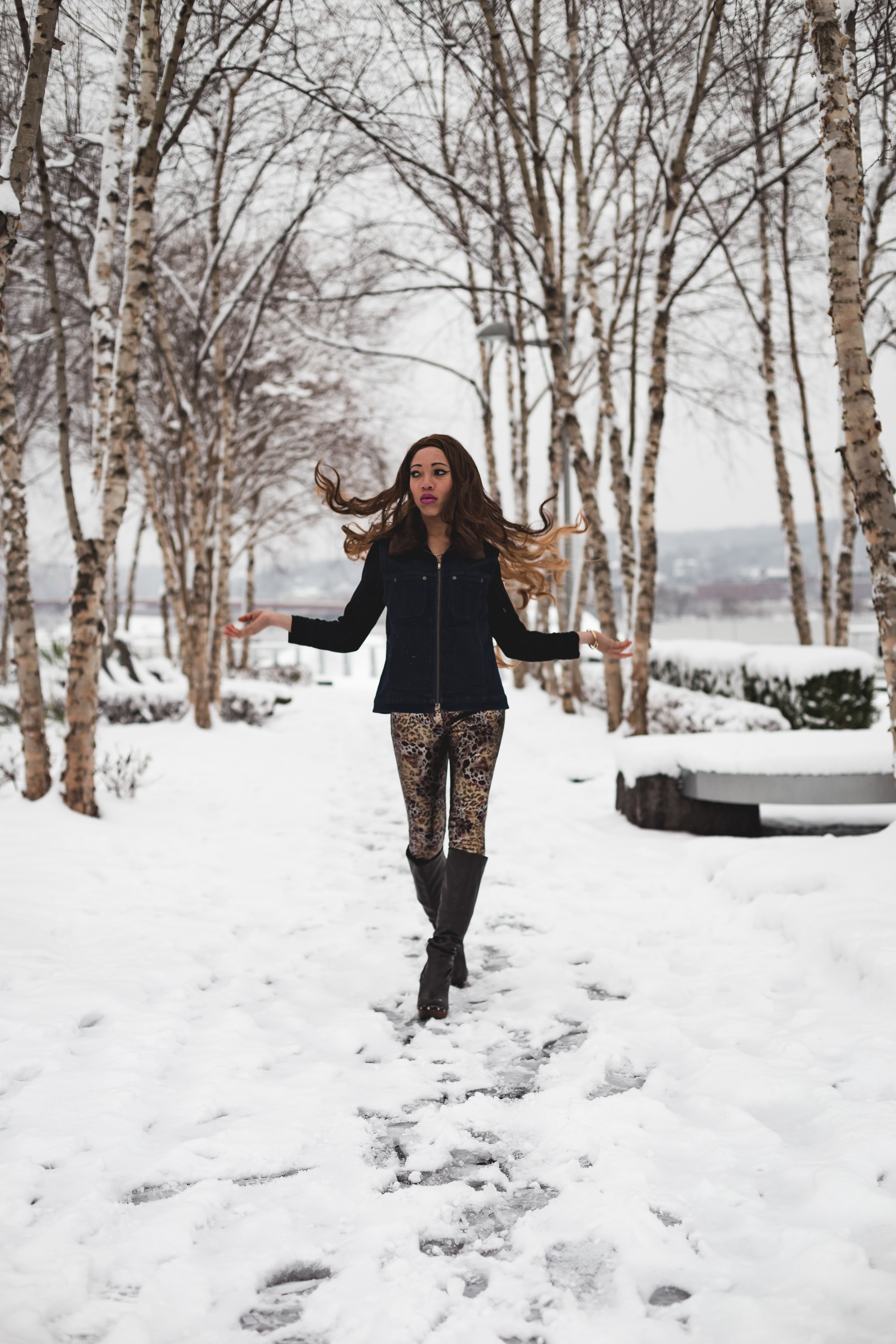woman walks at the middle of the snowfield