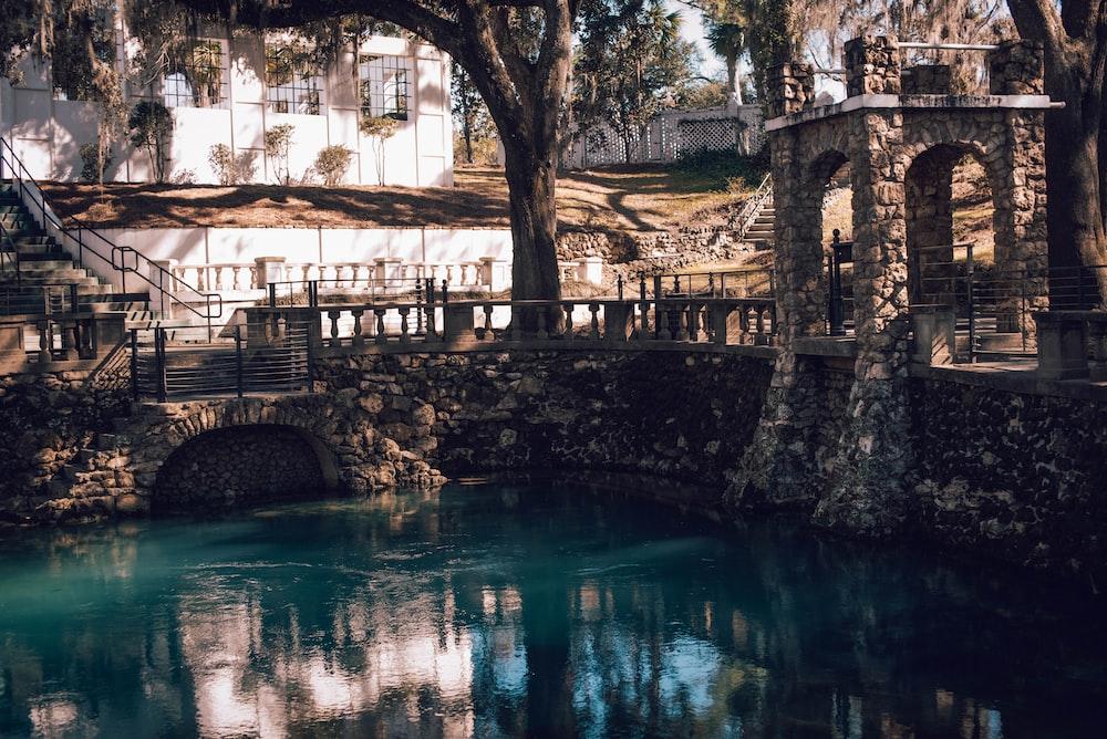 concrete bridge beside calm water