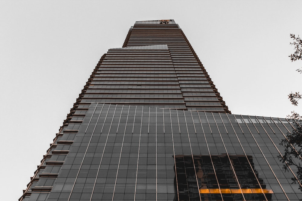 low angle view of glass window building