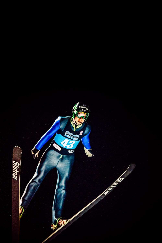 man riding ski blades illustration
