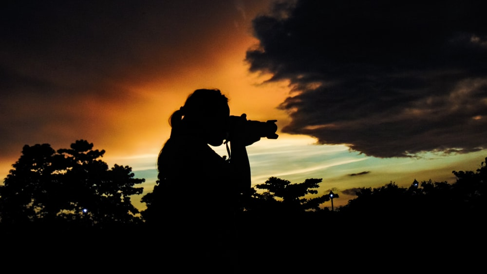 person taking photo of nature