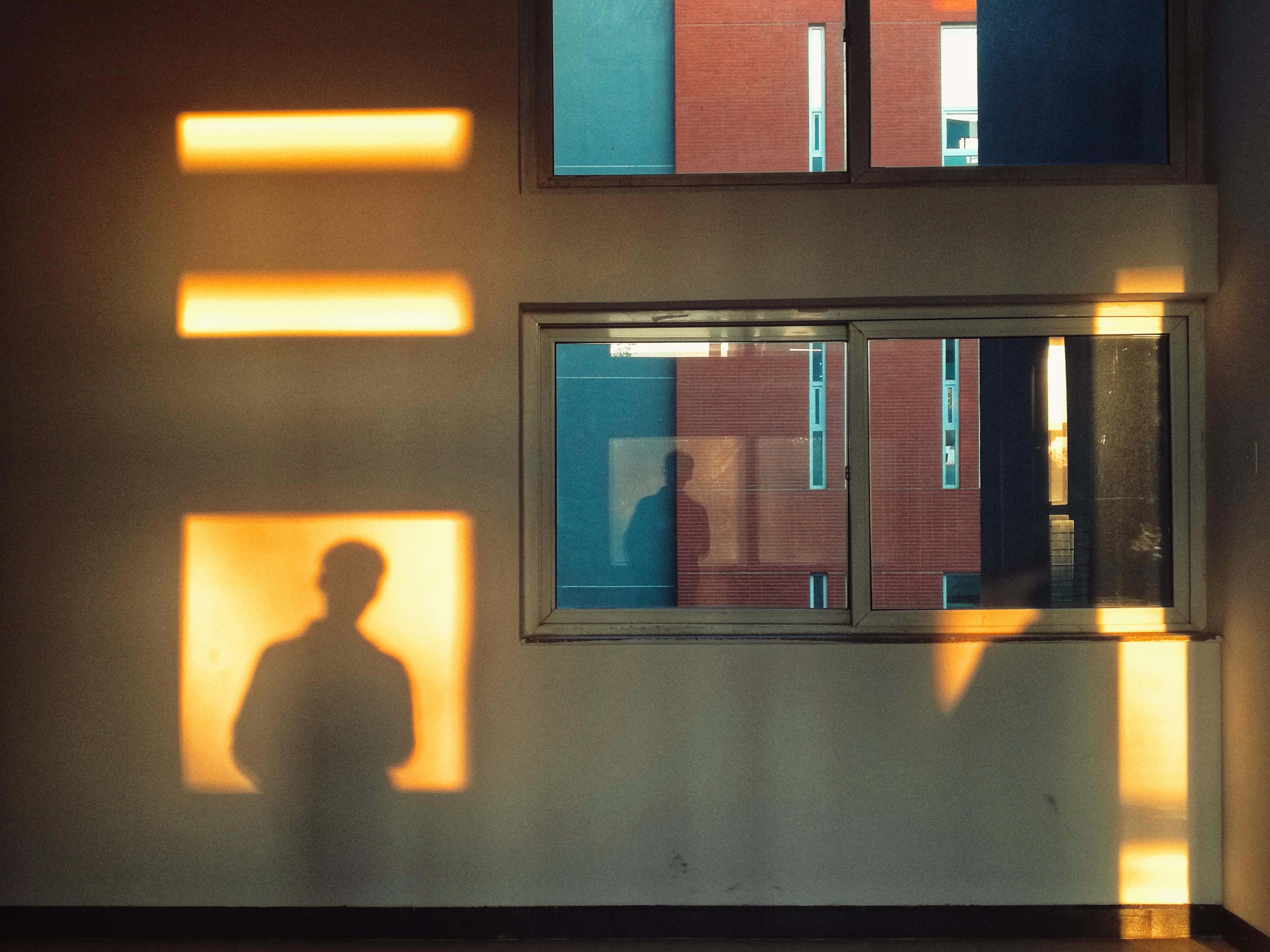 shadow of person near window