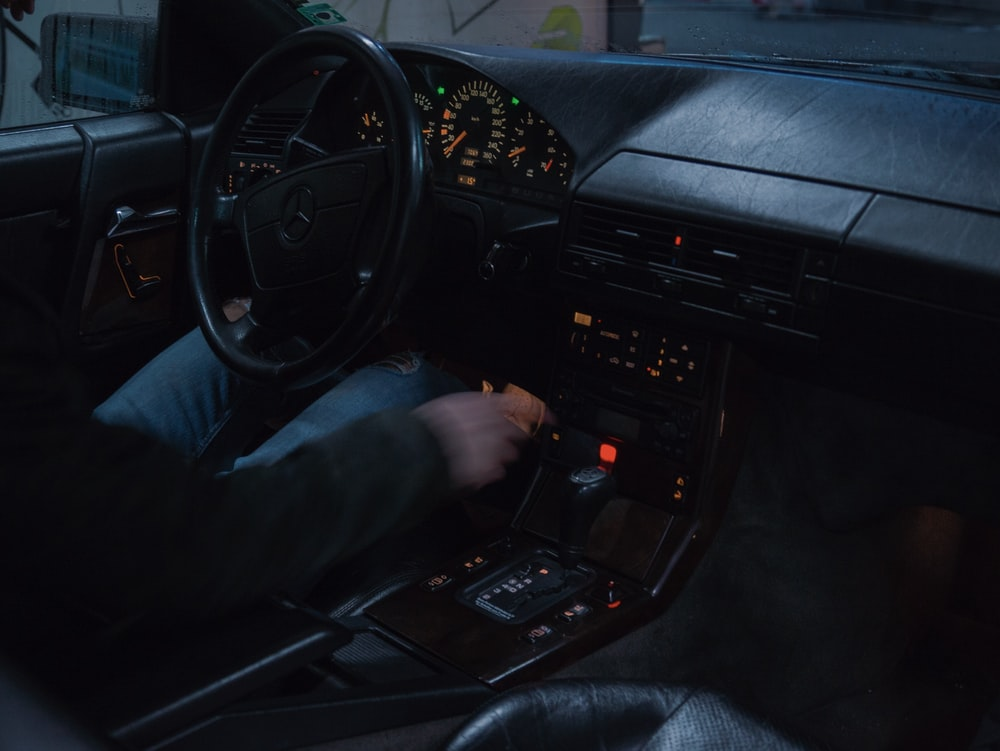 person driving car during nighttime