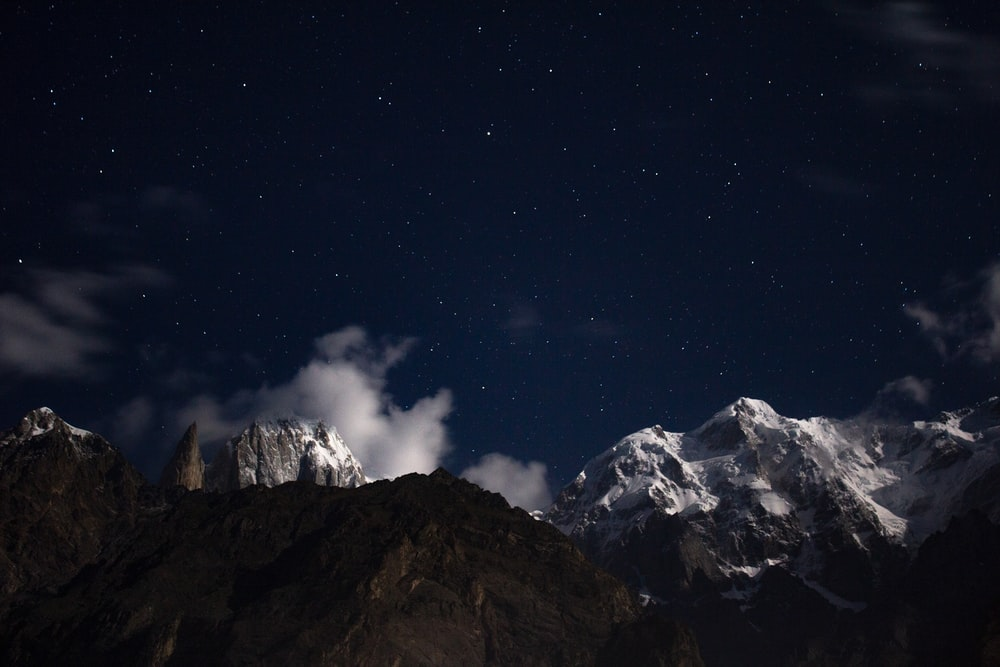 snow capped mountain under starry sky