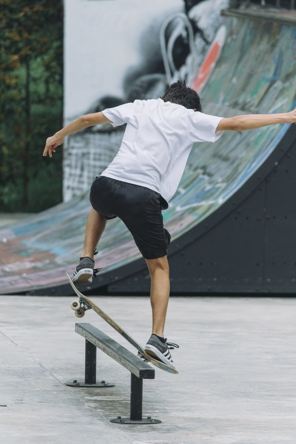man playing skateboard during daytime