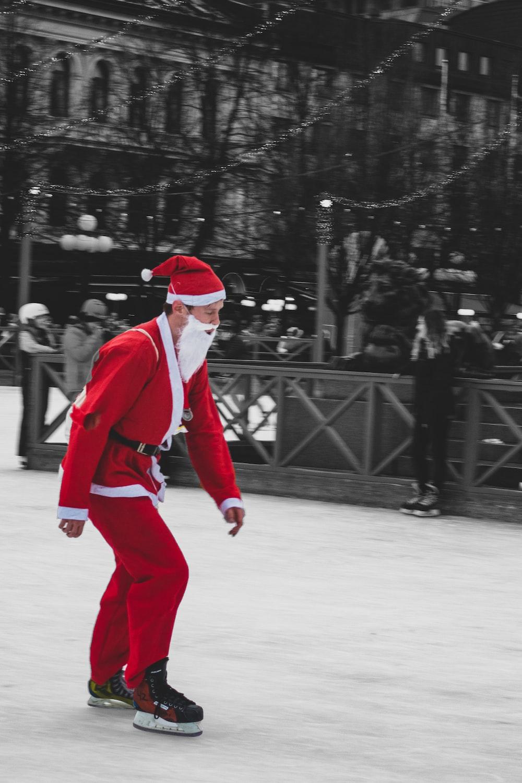 man wearing santa suit while using snow skin boots