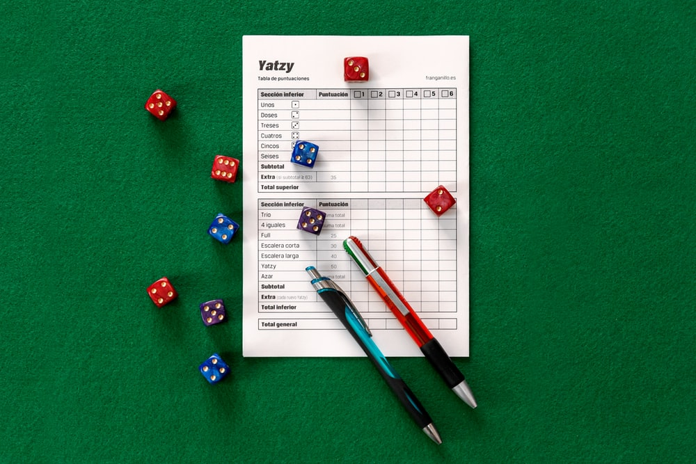 assorted-color dice on green surface