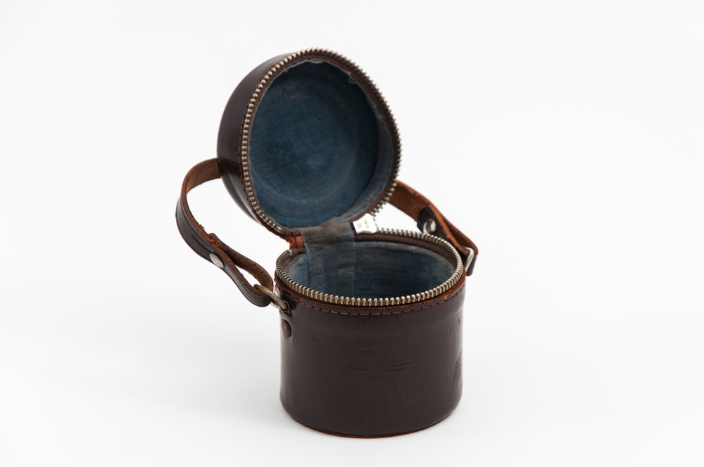 opened round brown leather bag