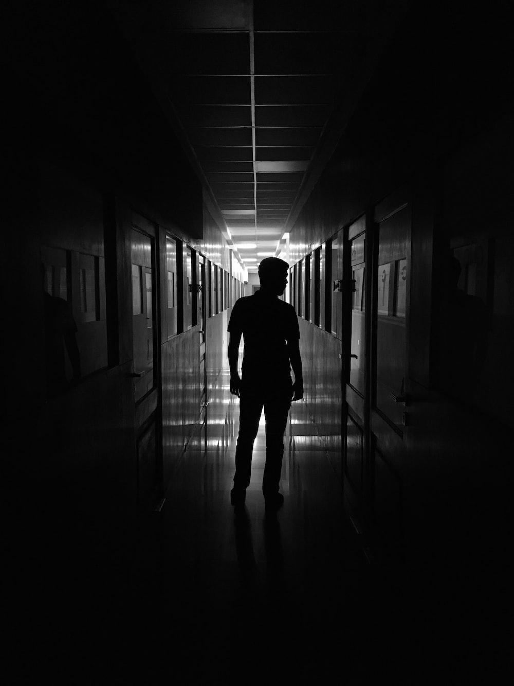 man standing in between rooms