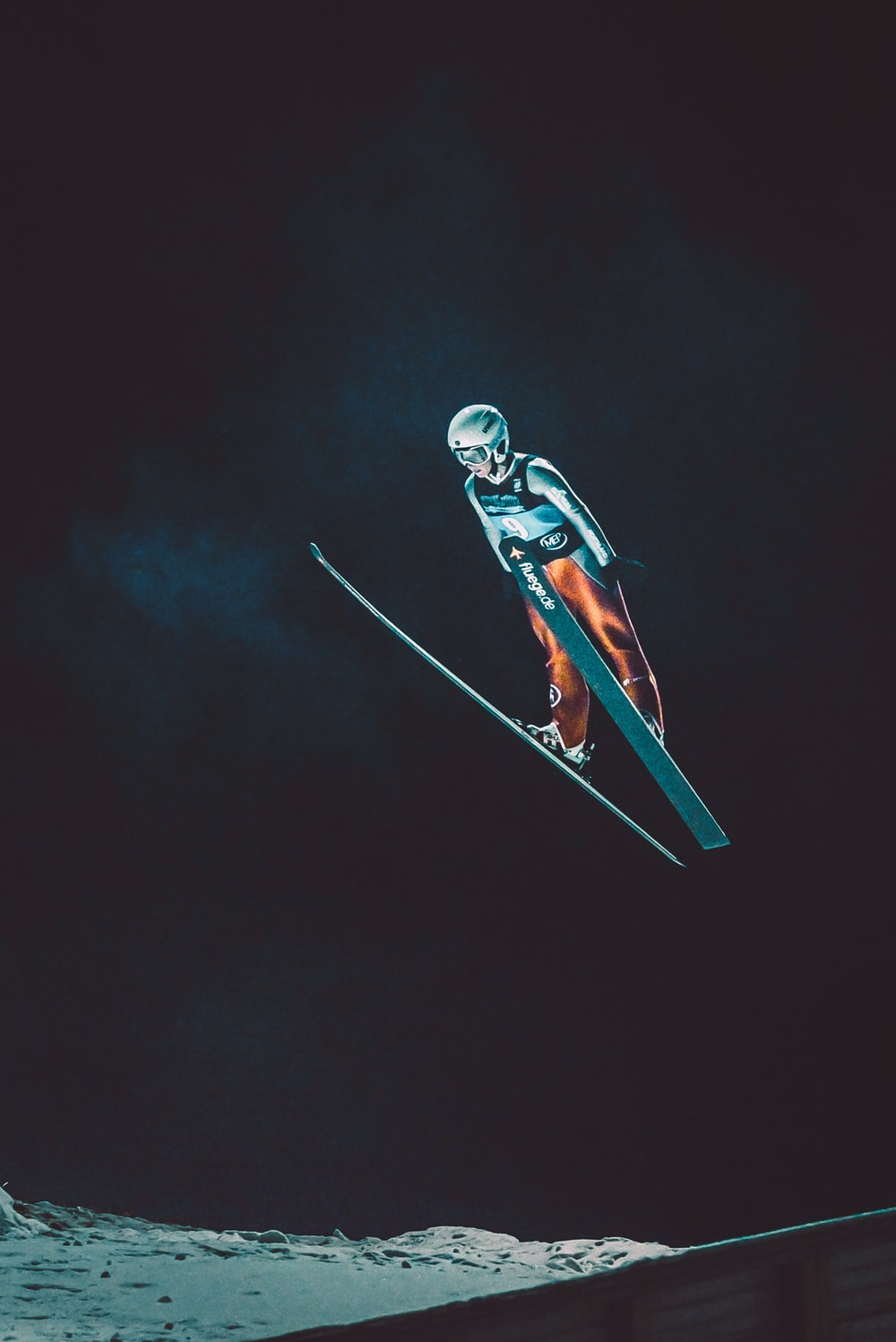 person skiing during nighttime