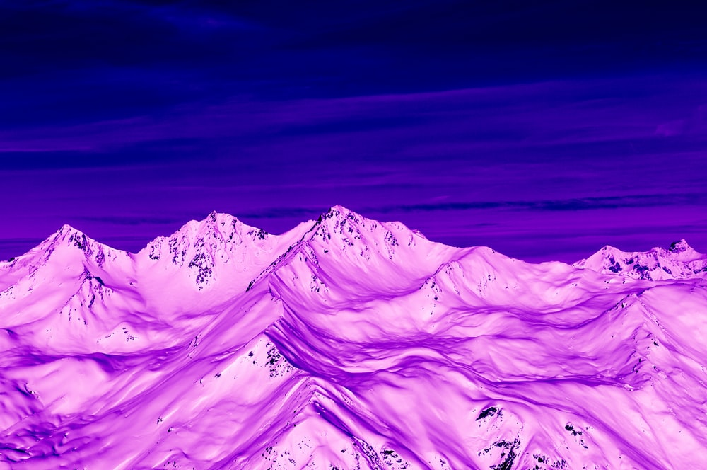 purple mountains under blue sky