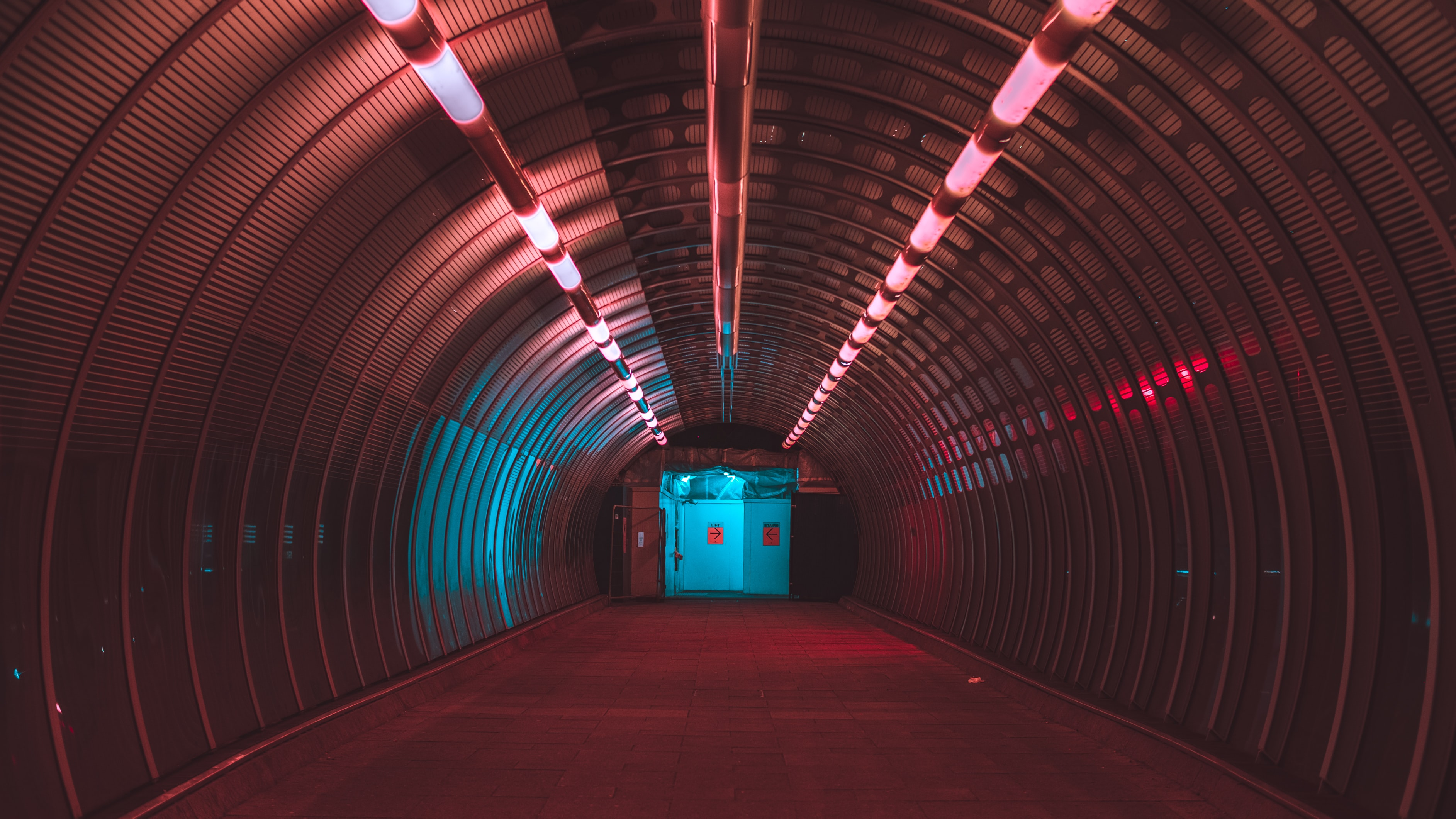 pink lighted tunnel with blue tunnel door